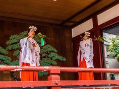 Two miko-san, (female attendants) of the Asakusa Jinja shrine performing a dance in their best celebratory outfits. #Asakusa, #Jinja, #Miko March, 18 2015 © Grigoris A. Miliaresis