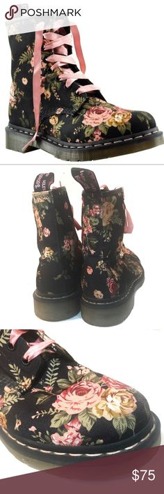 Dr.. Martens 1460 Floral Canvas Boots w Pink Laces A pair of Doc Martens 1460 Floral canvas boots.  They are black with a pink and green Victorian flowers pattern and pink satin laces.  Gently pre-owned in excellent condition with some mild signs of wear on the soles.  There are some black spots on one sole that I have tried to clean off but the spots don't come off. Size 8 US Size 39 Euro Dr. Martens Shoes Combat & Moto Boots