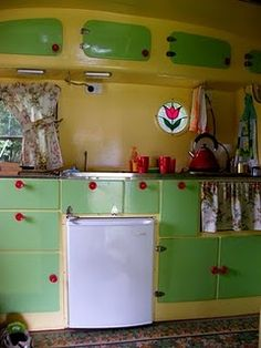 vintage caravan -- Oh me oh my! Now there's a caravan kitchen to dream about. I'd love to travel cross country with my pugs in a cool retro vintage camper all dolled up selling my books around the country. What an adventure! At least I can dream!