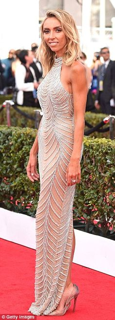 Bronzed beauty: Giuliana Rancic, 42, stunned in a jeweled halterneck gown and beachy blond...