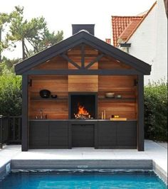 Universal Woodburning Open Fireplace from Metalfire ( in slideshow). Above floor outdoor fireplace between kitchen sink and prep area. Black cabinets and wood panels Backyard Kitchen, Backyard Patio, Summer Kitchen, Outdoor Rooms, Outdoor Dining, Design Barbecue, Parrilla Exterior, Bungalows, Outdoor Entertaining