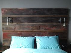 Barn board headboard with built in DIY pipe lights