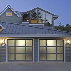 The pros and cons of installing glass (or tough plastic) garages. | Photo: Courtesy of Raynor.com