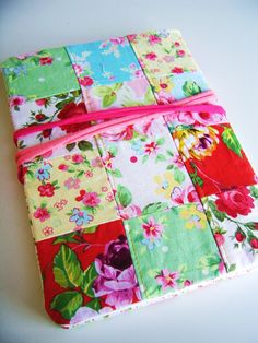 Handmade patchwork fabric covered Diary or Art Journaling book with lot of paper goodies. $35.50, via Etsy.