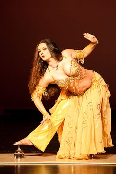 belly dancer ruby balances on glasses