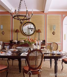 "The textured walls keep the dining room from feeling overly formal. ""It's not fabric—it's woven mats from Pearl River that we framed with moldings. They're actually yoga mats,"" says designer Courtney Coleman. It's a favorite decorator technique of ours—the texture is gorgeous."" Yoga mats by Pearl River.   - HouseBeautiful.com"