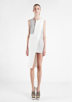 ASYMMETRICAL BALANCE: The white piece of the dress that overlaps and is double the length of the grey section of the dress creates asymmetrical balance.