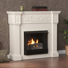 Colonial in inspiration and design, the Southern Enterprises Calvert Ivory Electric Fireplace showcases fluted columns that support the strong mantelpiece,. Gel Fireplace, Fireplace Drawing, Ethanol Fireplace, Fireplace Mantels, Fireplace Ideas, Mantles, Brick Fireplaces, Fireplace Heater, White Fireplace