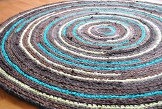 crochet rug- different colors but this is the idea for the rug.....strips of fabric crocheted.