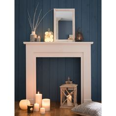 If you are looking to give your room a focal point or something to highlight it, look no further than the fireplace mantel that's already there. Many tend to leave their fireplace mantels bar… Candles In Fireplace, Fake Fireplace, Bedroom Fireplace, Fireplace Design, Fireplace Mantels, Living Room Decor, Bedroom Decor, Bedroom Candles, Upcycled Home Decor