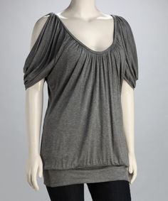Flirty cutout sleeves give a wink to fun on thiseleganttop. Created with curves in mind, it features a comfortable stretch fit and relaxed silhouette.94% rayon / 6% spandexMachine wash; dry flatMade in the USA