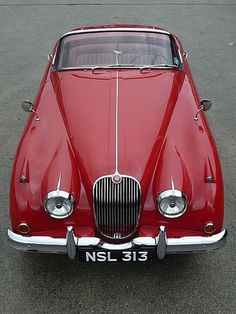 1958 Jaguar XK150 Absolutely gorgeous. Forget the E-Type, this is the most beautiful jag ever.