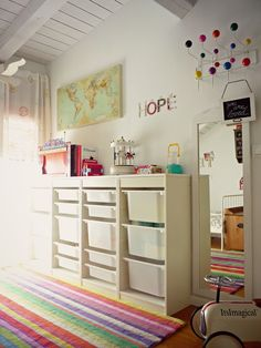 not usually a huge fan of the look of the ikea storage piece, but against so much white and with the pops of color and vintage pieces it melds into the wall offering lots of storage and style. Trofast Ikea, Creative Kids Rooms, Baby Deco, Ikea Storage, Storage Units, Storage Tubs, Toy Rooms, Kid Spaces, Kids Decor