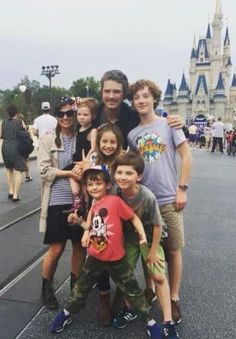 Taylor and Natalie with their 5 children at Disney world