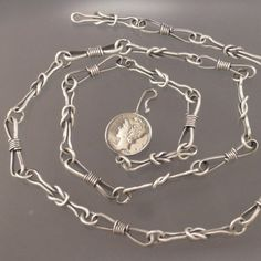 Mark Kaplan manly sailor's square knot necklace sterling silver. $177.77, via Etsy.