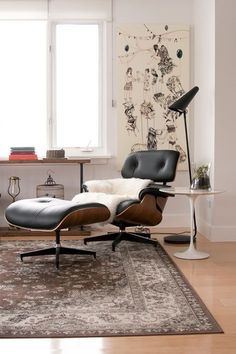 """The Eames lounge chair and ottoman by Herman Miller are accompanied by the Saarinen side table by Knoll. The lamp from Ikea was somewhat of a disappointment when I discovered the light source was a harsh LED bulb. I softened the LED with gels, and it makes for a great reading light (Stockholm lamp by Ikea). The shelving unit was a custom piece I designed after being inspired by a similar wall unit at the Ace Hotel in Palm Springs. And finally, the amazing artwork behind the chair is by…"