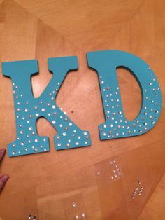 Kappa Delta letters for little...maybe do small to big pearls top to bottom