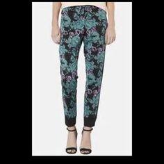 NWT Topshop floral Capri pants Topshop floral Capri pants- Black, Aqua and Purplish Flowers .. Size 10 Topshop Pants Capris