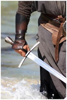 Warrior with a sword Knives And Swords, Swords And Daggers, Larp, Vikings, Leather Armor, Arm Armor, Medieval Times, Chivalry, Medieval Fantasy