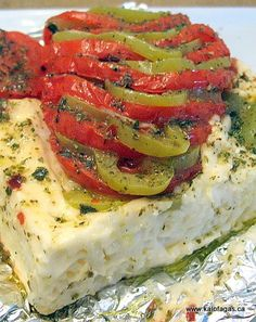 baked feta. I make this a fair amount. It's amazing. I usually bake red onion on top, as well; it's great served with raw vegan onion crackers, but any cracker/bread device will do it justice.