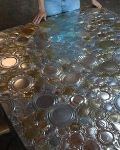 The Art Of Up-Cycling tin can lids and bottoms.. made into a table.. but I would love to see back splash or ceiling in a kitchen!  | Reduce. Reuse. Recycle.