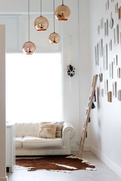 Eyelash Extension Salon in Scarborough, Perth. Designed by White Designs @sarah_white_designs Copper pendants hang over the lounge area. A White chesterfield sofa complements the feminine aspects of this space.