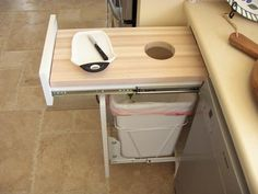 Pull-out cutting board and trash can. genius.