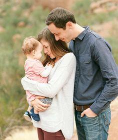 Parents looking lovingly at their child -- Family portrait shoot on Camelback Mountain -- Jaclyn, David & Emma - Phoenix Wedding Photographer - Melissa Jill Photography