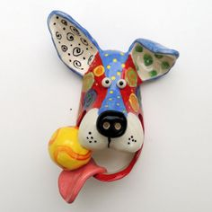 Original Handmade Ceramic Dog mask with Ball wall hanging by Dottie Dracos 12 Ceramic Animals, Clay Animals, Pottery Animals, Ceramic Mask, Ceramic Clay, Dog Sculpture, Pottery Sculpture, Paper Clay, Clay Art