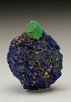 A cubooctahedral crystal of light green Malachite replaced Cuprite measuring to 7mm formed on a crystallized blue Azurite, from Chessy-les-Mines, France. Crystal Classics Minerals