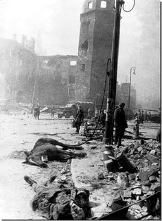 A dead German soldier lies in the foreground. Devastated Koenigsburg. April 1945. After the massive Russia assault. April 6-9, 1945