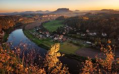Elbe River in autumn light - View from the Lilienstein Mountain down to the river Elbe in Saxon Switzerland, Germany.