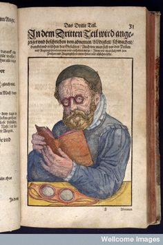 illustration shows early example of eyeglasses or spectacles being worn while reading a book, in medieval book [Ophthalmodouleia] Das ist Augendienst, by Georg Bartisch, published Dresden, Germany, 1583 / Wellcome Library, London, UK