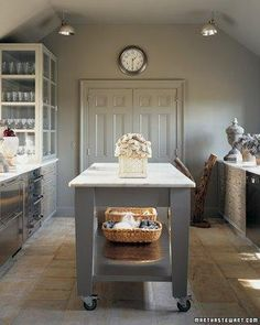 Martha Stewart: Gray kitchen design with gray walls paint color, rolling gray kitchen island with ...