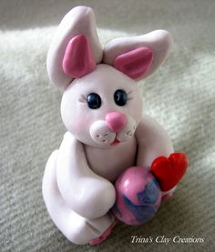 Polymer Clay Bunny With an Easter Egg. $15.00, via Etsy.
