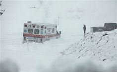 Belington, W.Va.  An ambulance is stuck in over a foot of snow off of Highway 33 West, near Belington, W.Va. on Tuesday, Oct. 30, 2012, in Belington, W.Va. Superstorm Sandy buried parts of West Virginia under more than a foot of snow on Tuesday, cutting power to at least 264,000 customers and closing dozens of roads. At least one death was reported. The storm not only hit higher elevations hard as predicted, communities in lower elevations got much more than the dusting of snow forecasted