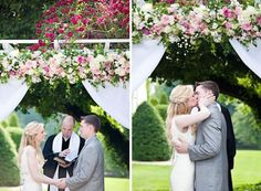 The couple's first kiss as husband and wife under an array of beautiful pink and white flowers.