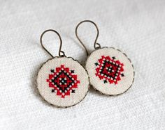 These amazing Ethnic Ukrainian earrings with black and red embroidery are a stylish and eye-catching accessory. They are embroidered on linen fabric with cotton embroidery floss. These earrings will add traditional and sacred spirits to your style. Textile Jewelry, Embroidery Jewelry, Hand Embroidery Patterns, Fabric Jewelry, Beaded Embroidery, Cross Stitch Embroidery, Cross Stitch Patterns, Embroidery Designs, Cross Stitching