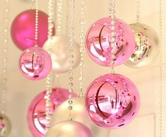 Use a simple string of pearl beads to hang  ornaments! ...would make a cute back drop
