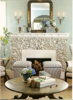 Oyster shells on the fireplace. I love it!