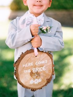 Positively precious ring bearer and his rustic sign | Leo Patrone Photography