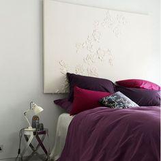 beautiful headboard and purple bedding