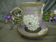 Ceramic Teacup and Saucer with Zinnia Flowers in Lavender, Summer White and Black Mountain by Sally Anne Stahl. www.clayshapergallery.com