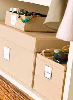 Eliminate mystery drawers and keep similar things together by organizing items in labeled linen boxes. Find boxes available in a variety of sizes to accommodate different items. This is a great solution to stash smaller items, such as sunglasses, in an easy-to-find spot.
