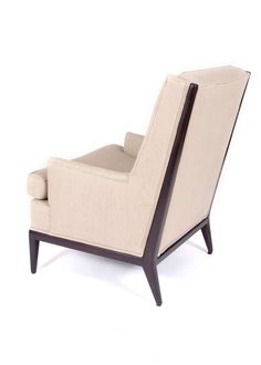 T.H. Robsjohn-Gibbings; Walnut Frame Lounge Chair for Widdicomb, 1950s.