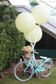 gorgeous mint bicycle with balloons and flowers / http://www.himisspuff.com/bicycle-wedding-ideas/6/