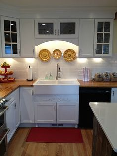 Modern Farmhouse Kitchen With Ikea Adel Cabinetry Butcherblock