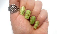 Simple St.Patrick's Day Celtic shamrock nail art design.