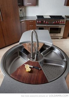 Awesome kitchen gadgets: A rotating sink… the Wolf Range in the back doesn't look bad either.