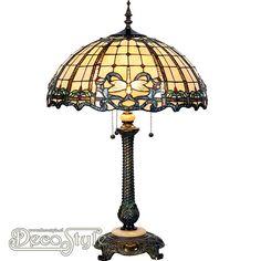 Tiffany Tafellamp Radevan Dragonfly  Een bijzonder mooie tafellamp. Helemaal met de hand gemaakt van echt Tiffanyglas. Dit originele glas zorgt voor de warme uitstraling. De voet is vervaardigd van bronskleurig metaal en marmer. Met 3x grote fitting (E27). Met 3 schakelaars aan de kap. Afmetingen: Hoogte: 80 cm Diameter Kap: 50 cm